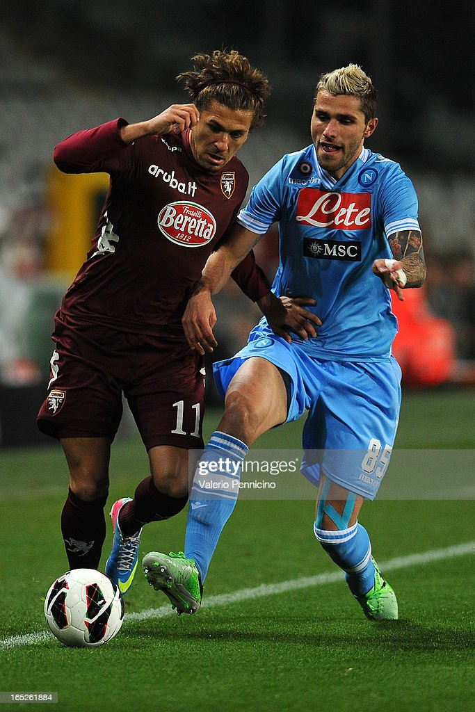 Alessio Cerci (L) of Torino FC is challenged by <a gi-track='captionPersonalityLinkClicked' href=/galleries/search?phrase=Valon+Behrami&family=editorial&specificpeople=453450 ng-click='$event.stopPropagation()'>Valon Behrami</a> of SSC Napoli during the Serie A match between Torino FC and SSC Napoli at Stadio Olimpico di Torino on March 30, 2013 in Turin, Italy.