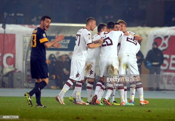 Alessio Cerci of Torino FC is mobbed by teammates after scoring his team's second goal during the Serie A match between Hellas Verona FC and Torino...