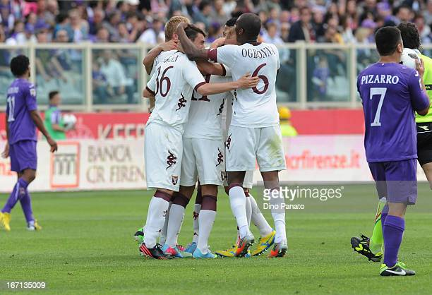 Alessio Cerci of Torino FC is surrounded by teammates in celebration after he scored their team's third goal during the Serie A match between ACF...