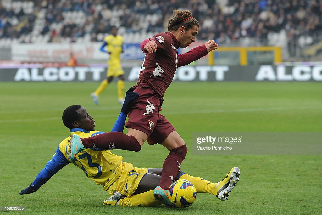 Alessio Cerci (R) of Torino FC is tackled by Drame Boukary of AC Chievo Verona during the Serie A match between Torino FC and AC Chievo Verona at Stadio Olimpico di Torino on December 22, 2012 in Turin, Italy.
