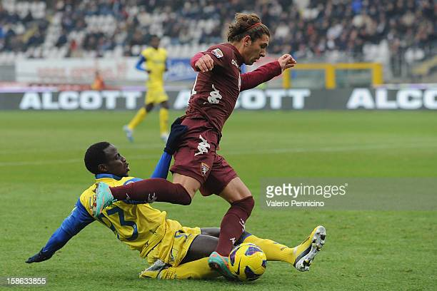 Alessio Cerci of Torino FC is tackled by Drame Boukary of AC Chievo Verona during the Serie A match between Torino FC and AC Chievo Verona at Stadio...