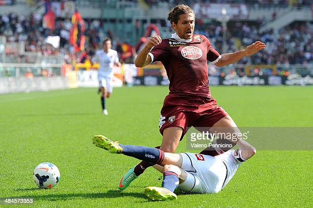 Alessio Cerci of Torino FC is tackled by Luca Antonelli of Genoa CFC during the Serie A match between Torino FC and Genoa CFC at Stadio Olimpico di...