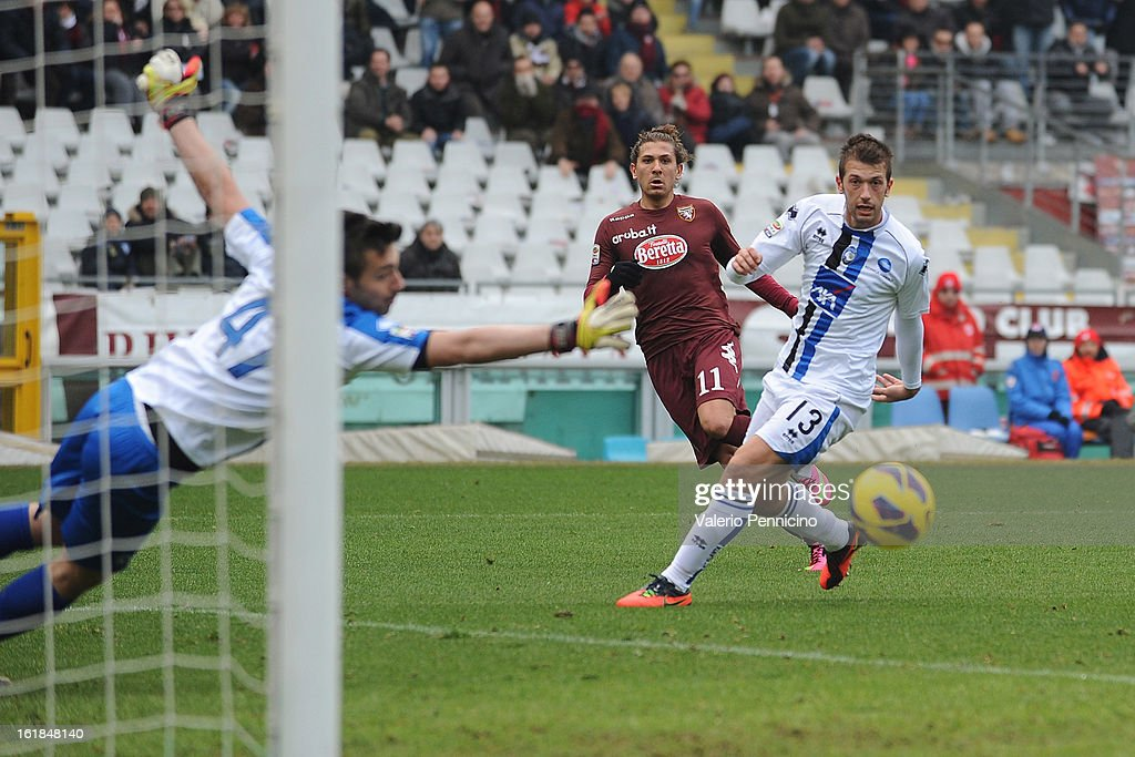 Alessio Cerci (C) of Torino FC scores the opening goal during the Serie A match between Torino FC and Atalanta BC at Stadio Olimpico di Torino on February 17, 2013 in Turin, Italy.