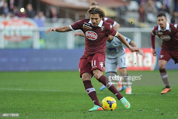 Alessio Cerci of Torino FC scores the opening goal from the penalty spot during the Serie A match between Torino FC and Atalanta BC at Stadio...