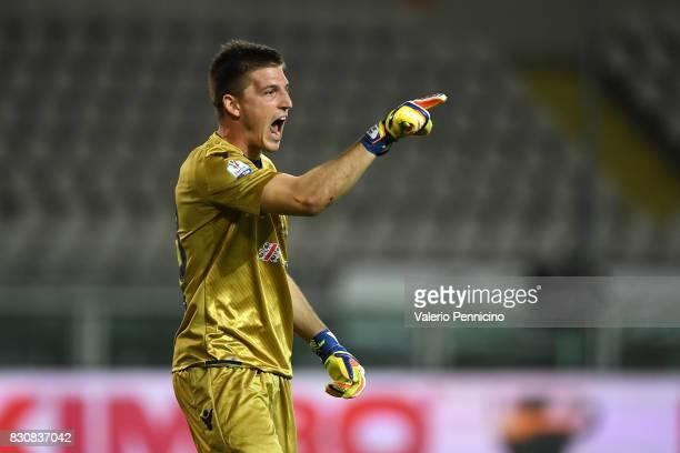 Alessio Cragno of Cagliari Calcio celebrates after having spared a penalty during the TIM Cup match between Cagliari Calcio and US Citta di Palermo...