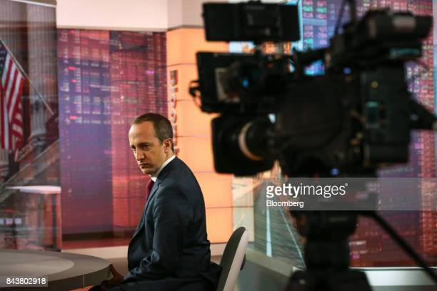 Alessio de Longis vice president of macro for OppenheimerFunds Inc listens during a Bloomberg Television interview in New York US on Thursday Sept 7...