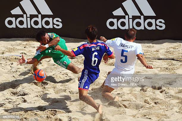 Alessio Frainetti of Italy treis to score against Naoya Matsuo and goalkeeper Shingo Terukina of Japan during the FIFA Beach Soccer World Cup...