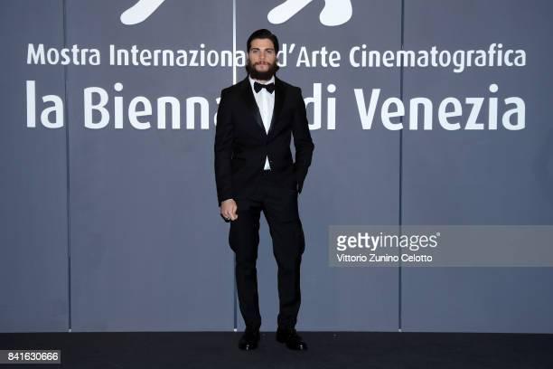 Alessio Lapice walks the red carpet ahead of the 'Nato A Casal Di Principe' screening during the 74th Venice Film Festival at Sala Giardino on...