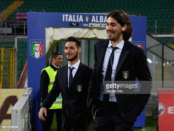 Alessio Romagnoli and Matteo Politano of Italy look on during the Italy pitch inspection at Stadio Renzo Barbera on March 23 2017 in Palermo Italy