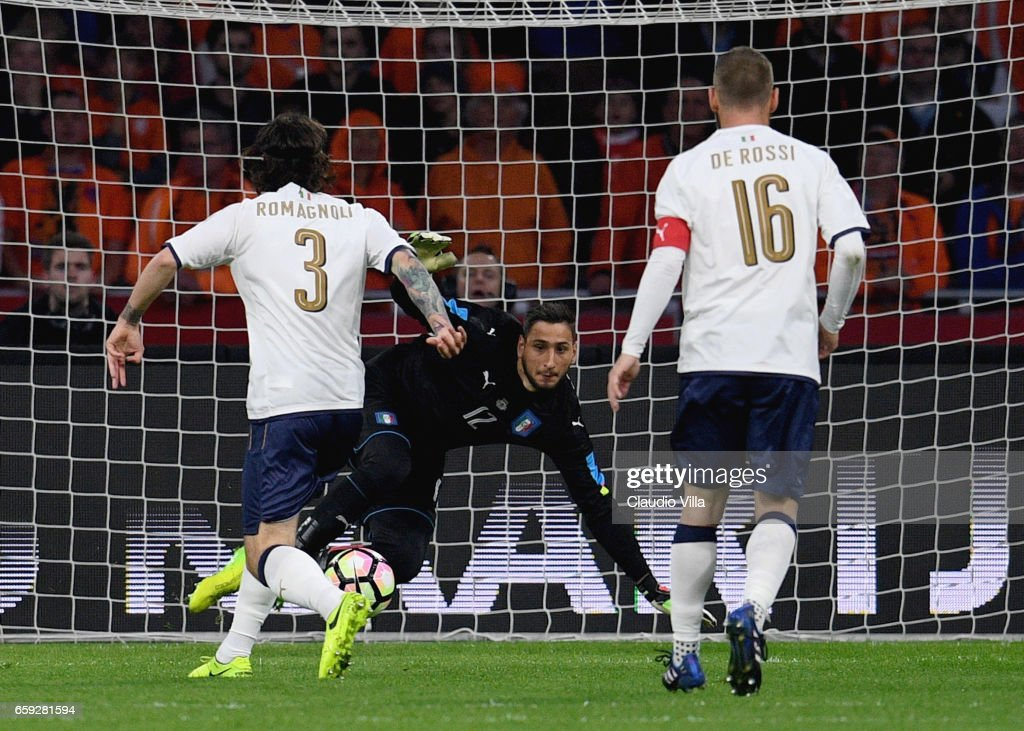 Alessio Romagnoli makes an auto goal during the international friendly match between Netherlands and Italy at Amsterdam Arena on March 28, 2017 in Amsterdam, Netherlands.