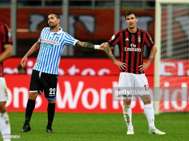 Alessio Romagnoli of AC Milan and Marco Borriello of Spal chat during the Serie A match between AC Milan and Spal at Stadio Giuseppe Meazza on...
