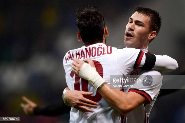 Alessio Romagnoli of AC Milan celebrates with Hakan Calhanoglu after scoring a goal during the Serie A football match between US Sassuolo and AC...