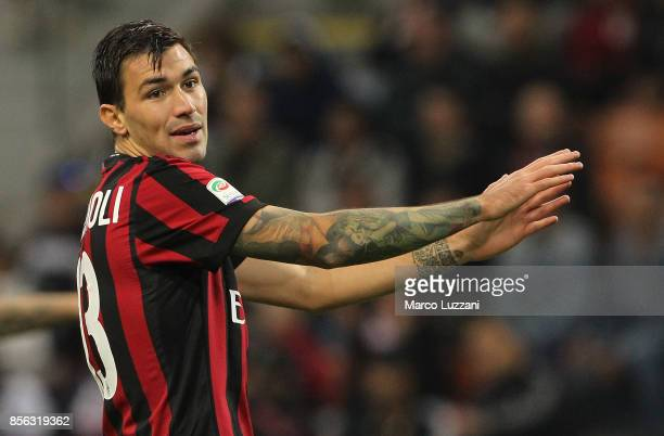 Alessio Romagnoli of AC Milan gestures during the Serie A match between AC Milan and AS Roma at Stadio Giuseppe Meazza on October 1 2017 in Milan...