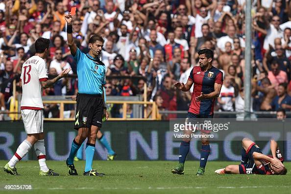 Alessio Romagnoli of AC Milan receives the red card from referee Paolo Tagliavento during the Serie A match between Genoa CFC and AC Milan at Stadio...