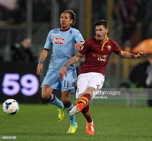 Alessio Romagnoli of AS Roma competes for the ball with Alessio Cerci of Torino FC during the Serie A match between AS Roma and Torino FC at Stadio...