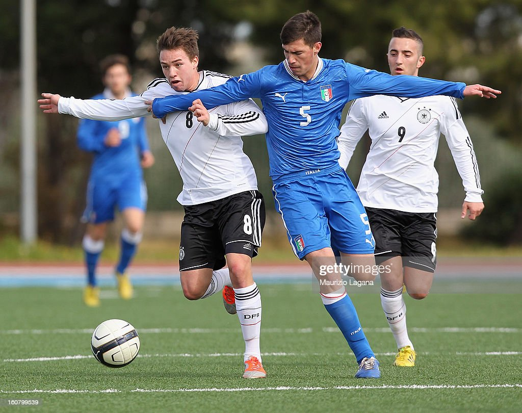 Alessio Romagnoli (R) of Italy competes for the ball with Thomas Pledl of Germany during Under 19 International Friendly match between Italy and Germany at Stadio Comunale San Pio on February 6, 2013 in Santo Spirito near Bari, Italy.