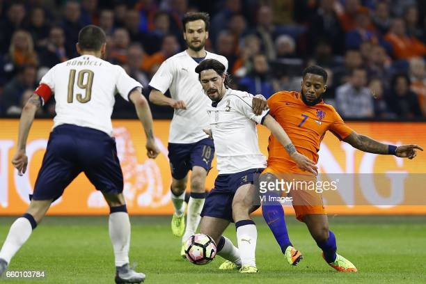 Alessio Romagnoli of Italy Jeremain Lens of Hollandduring the friendly match between Netherlands and Italy at the Amsterdam Arena on March 28 2017 in...