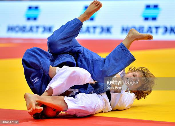 Alesya Kuznetsova of Russia armlocks Sabrina Saidi of Algeria to submit and win their u48kg contest by an ippon during the Chelyabinsk Judo World...
