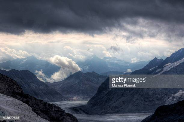 Aletsch glacier and rocky mountain peaks