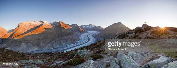Aletsch Glacier at first morning light with photographer, from Moosfluh, Riederalp, Valais, Switzerland, Europe
