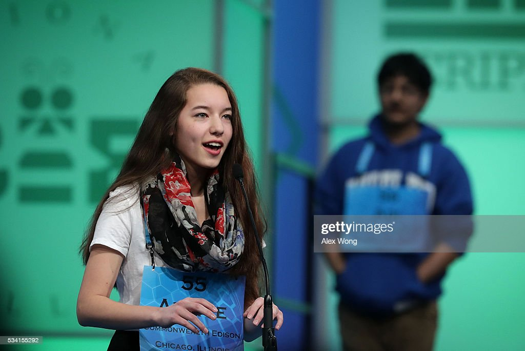 Alette Eide (L) of Homer Glen, Illinois, participates in round two of the 2016 Scripps National Spelling Bee May 25, 2016 in National Harbor, Maryland. Students from across the country gathered to compete for top honor of the annual spelling championship.