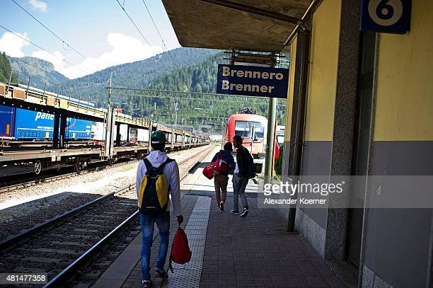 Alex a 28yearold from Ethiopia 19yearold Abel and 16yearold Rick walk on a plattform towards a train to Innsbruck Austria at the Brenner Pass at the...
