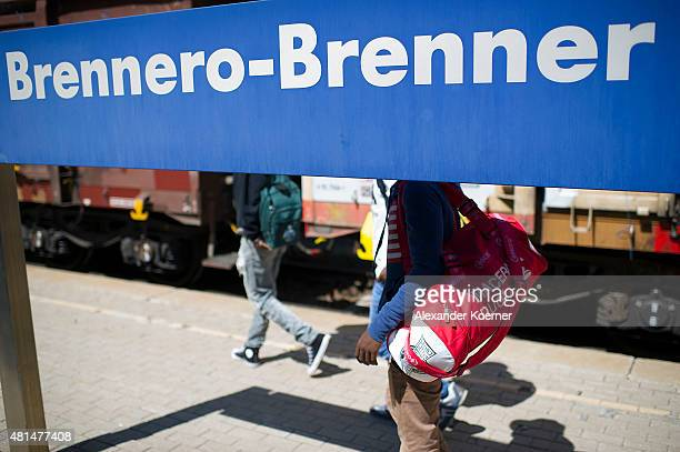 Alex a 28yearold from Ethiopia and 19yearold Abel walk on a plattform towards a train to Innsbruck Austria at the Brenner Pass at the Austrian border...
