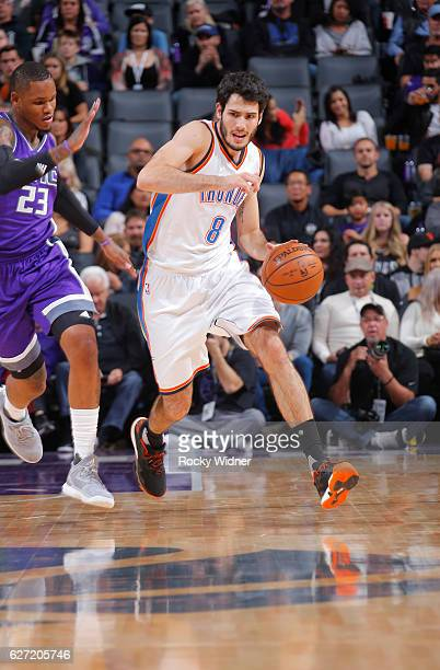 Alex Abrines of the Oklahoma City Thunder brings the ball up the court against Ben McLemore of the Sacramento Kings on November 23 2016 at Golden 1...