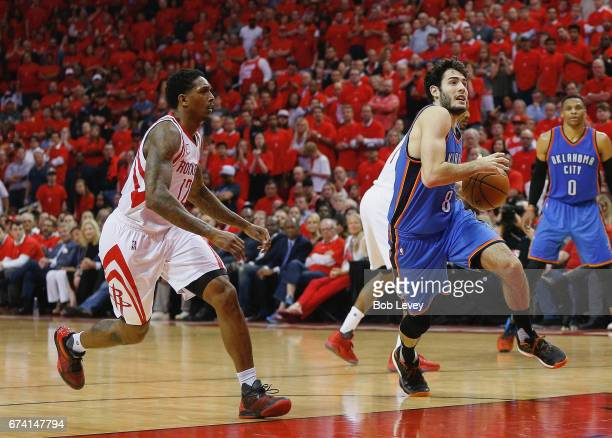 Alex Abrines of the Oklahoma City Thunder drives to the basket pursued by Lou Williams of the Houston Rockets during Game Five of the Western...