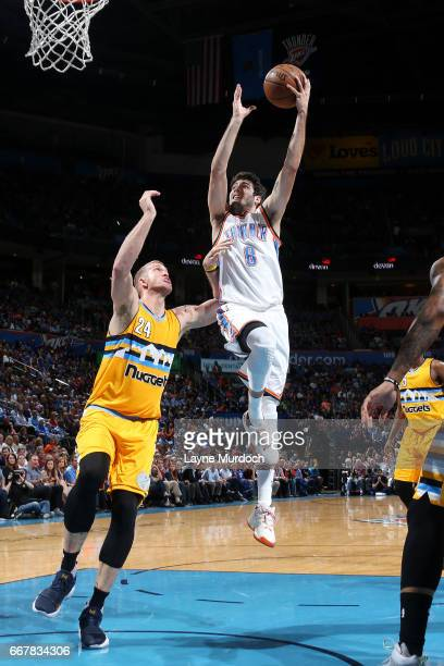 Alex Abrines of the Oklahoma City Thunder goes for a lay up during the game against the Denver Nuggets on April 12 2017 at Chesapeake Energy Arena in...