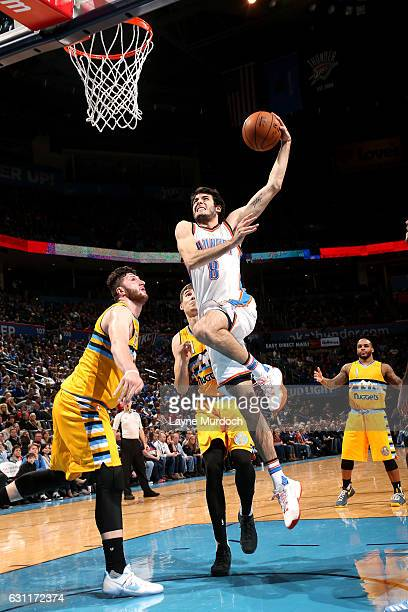 Alex Abrines of the Oklahoma City Thunder goes for the dunk during the game against the Denver Nuggets on January 7 2017 at Chesapeake Energy Arena...