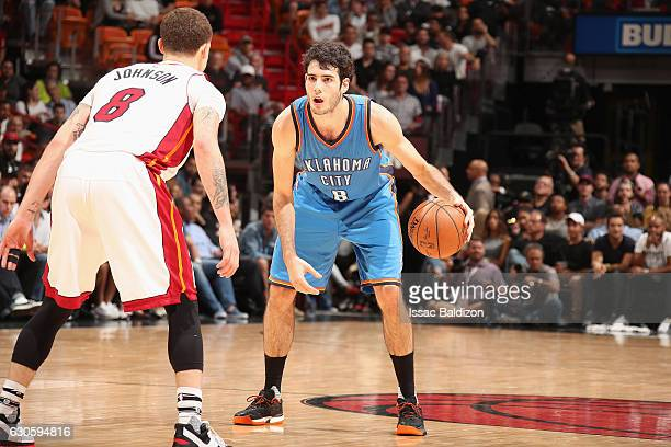 Alex Abrines of the Oklahoma City Thunder handles the ball against the Miami Heat on December 2016 at American Airlines Arena in Miami Florida NOTE...