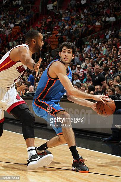 Alex Abrines of the Oklahoma City Thunder handles the ball against the Miami Heat on December 27 2016 at American Airlines Arena in Miami Florida...