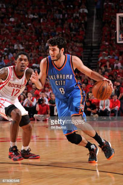 Alex Abrines of the Oklahoma City Thunder handles the ball against the Houston Rockets in Game Five of the Western Conference Quarterfinals of the...