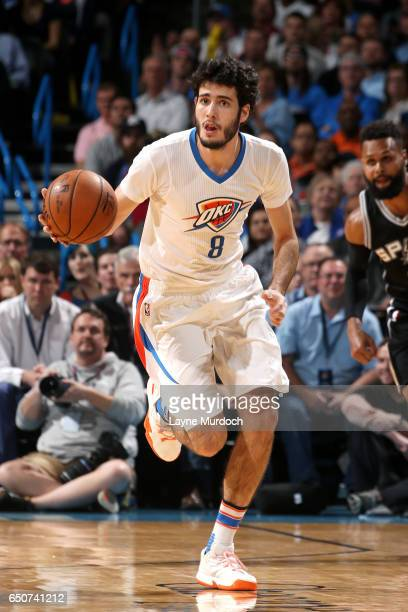 Alex Abrines of the Oklahoma City Thunder handles the ball during the game against the San Antonio Spurs on March 9 2017 at Chesapeake Energy Arena...