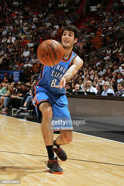 Alex Abrines of the Oklahoma City Thunder passes the ball against the Miami Heat on December 27 2016 at American Airlines Arena in Miami Florida NOTE...