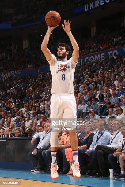 Alex Abrines of the Oklahoma City Thunder shoots the ball against the Golden State Warriors on March 20 2017 at Chesapeake Energy Arena in Oklahoma...