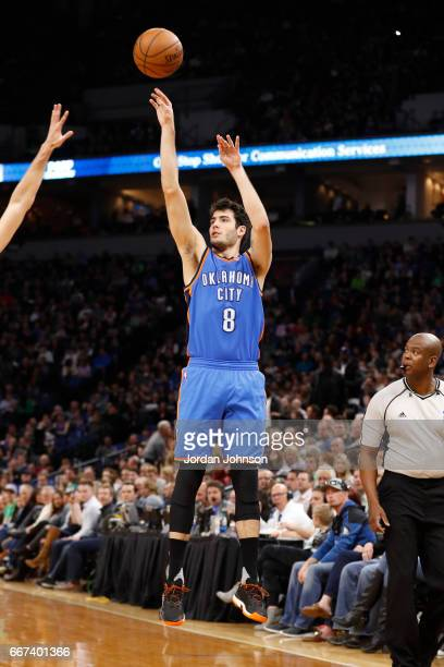Alex Abrines of the Oklahoma City Thunder shoots the ball against the Minnesota Timberwolves on April 11 2017 at Target Center in Minneapolis...