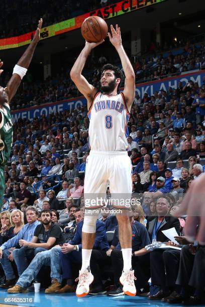 Alex Abrines of the Oklahoma City Thunder shoots the ball during the game against the Milwaukee Bucks on April 4 2017 at Chesapeake Energy Arena in...