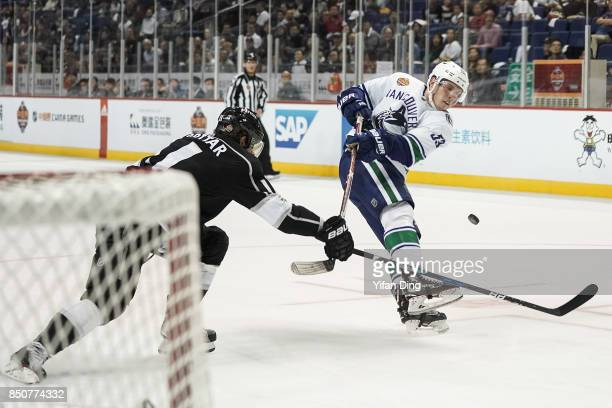 Alex Adler of Vancouver Canucks takes a shot against Anze Kopitar during a preseason National Hockey League game between the Vancouver Canucks and...