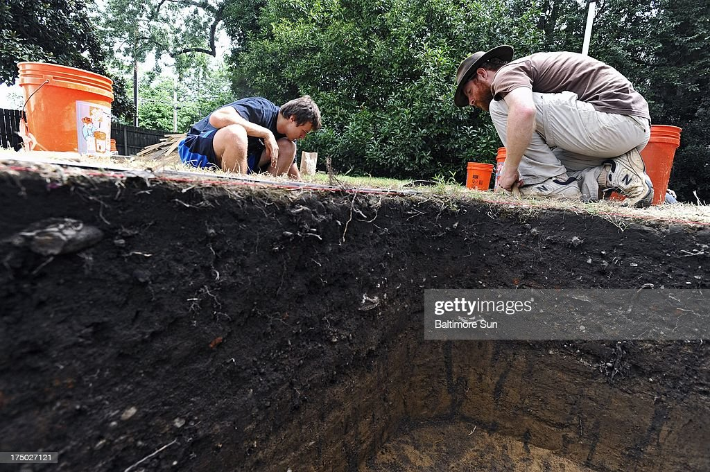 Alex Agarunov, left, a senior at University of Maryland, and Ph.D. candidate Tracy Jenkins, right, work at the archaeological dig site 'The Hill,' in Easton, Maryland, July 24, 2013. UMD in collaboration with Morgan State University is conducting an archaeological dig at 'The Hill,' which may be the oldest settlement of free African-Americans in the U.S.