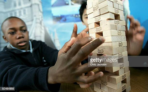 Alex Agboola and John Chua attempts to break his teams previous Jenga record of 30 levels in 11 minutes and 55 seconds at The Walkways Tower Bridge...