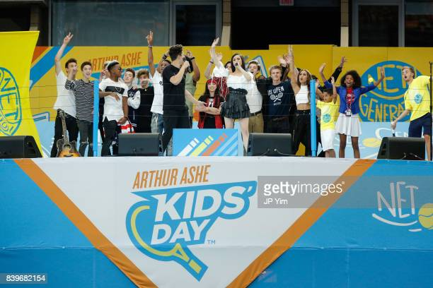 Alex Aiono Sofia Carson wave goodbye to the fans at the 22nd Annual Arthur Ashe Kid's Day event at the USTA Billie Jean King National Tennis Center...