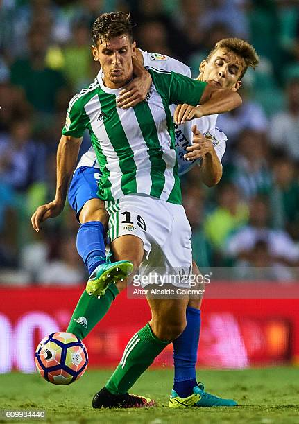 Alex Alegria of Real Betis Balompie competes for the ball with Diego Llorente of Malaga CF during the match between Real Betis Balompie vs Malaga CF...