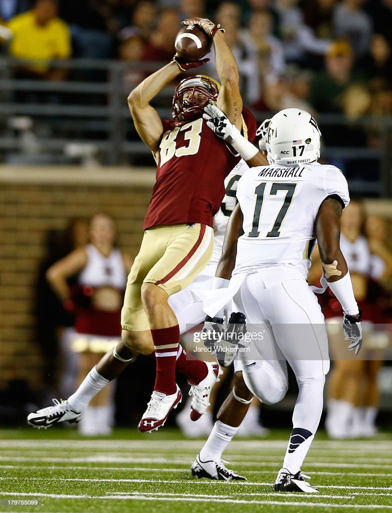 Alex Amidon #83 of the Boston College Eagles catches a pass in front of A.J. Marshall #17 of the Wake Forest Demon Deacons in the first quarter during the game on September 6, 2013 at Alumni Stadium in Chestnut Hill, Massachusetts.