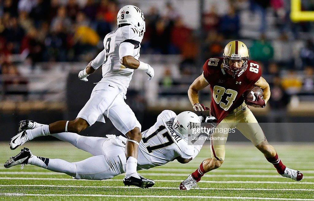 Alex Amidon #83 of the Boston College Eagles runs with the ball through A.J. Marshall #17 of the Wake Forest Demon Deacons after catching a pass in the third quarter during the game on September 6, 2013 at Alumni Stadium in Chestnut Hill, Massachusetts.