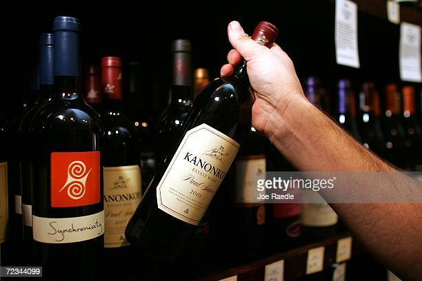 Alex Andavert stocks the shelves with bottles of red wine at Old Vines Wine Spirits on November 1 2006 in Miami Florida A study by the Harvard...