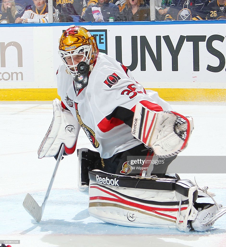 <a gi-track='captionPersonalityLinkClicked' href=/galleries/search?phrase=Alex+Auld&family=editorial&specificpeople=217975 ng-click='$event.stopPropagation()'>Alex Auld</a> #35 of the Ottawa Senators gets a piece of the puck which then deflected into the net for a third period goal by Ville Leino of the Buffalo Sabres (not shown) at First Niagara Center on November 11, 2011 in Buffalo, New York.