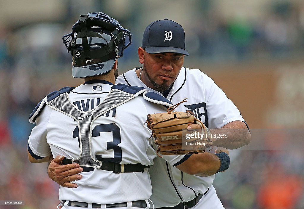 <a gi-track='captionPersonalityLinkClicked' href=/galleries/search?phrase=Alex+Avila&family=editorial&specificpeople=5749211 ng-click='$event.stopPropagation()'>Alex Avila</a> #13 and Joaquin Benoit #53 of the Detroit Tigers celebrate a win over the Kansas City Royals at Comerica Park on September 15, 2013 in Detroit, Michigan. The Tigers defeated the ROyals 3-2.