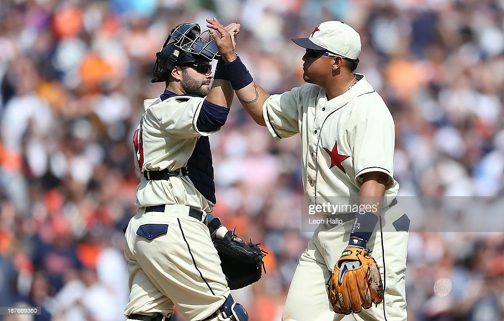 Alex Avila #13 and Miguel Cabrera #24 of the Detroit Tigers celebrate a win over the Atlanta Braves at Comerica Park on April 27, 2013 in Detroit, Michigan. The Tigers defeated the Braves 7-4.